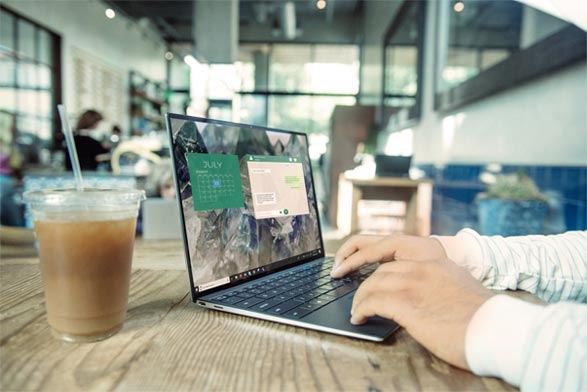 Using a laptop in a cafe